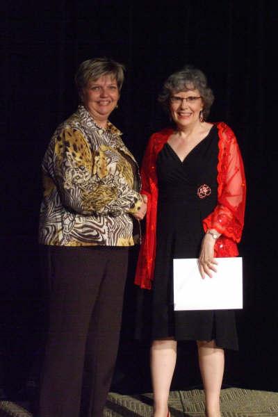 N. J. Lindquist getting an award sponsored by Faith Life Financial