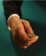 Man holding quarter